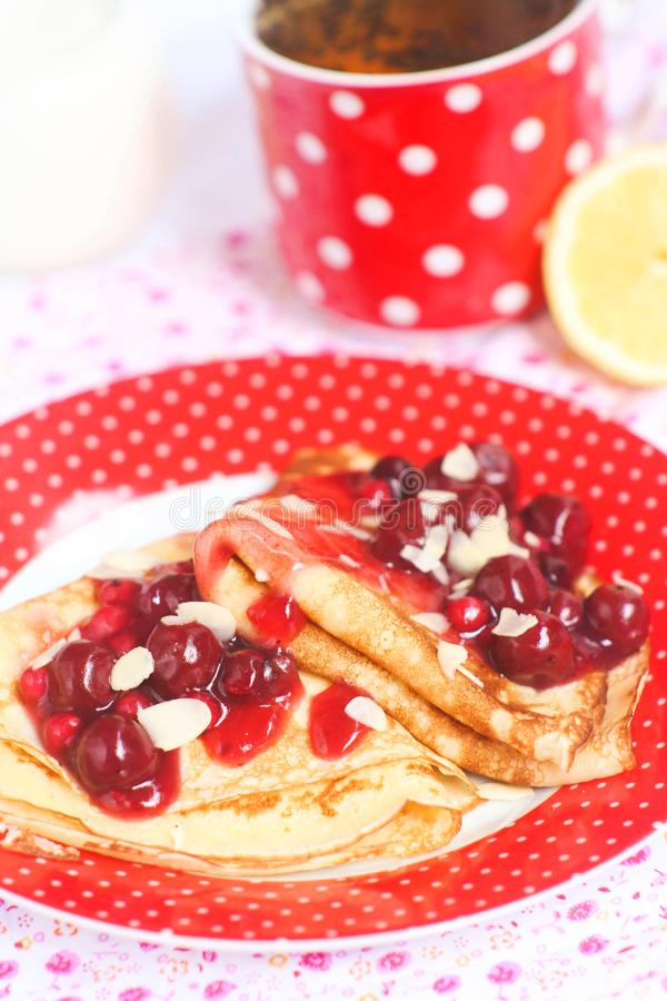 Homemade sweet pancakes with cherries royalty free stock images