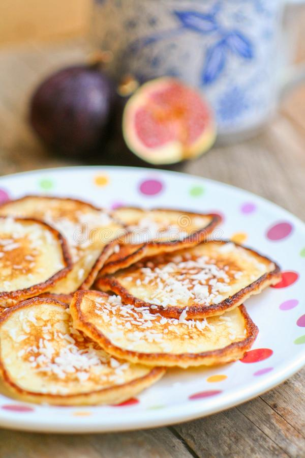 Homemade sweet pancakes with coconut royalty free stock image