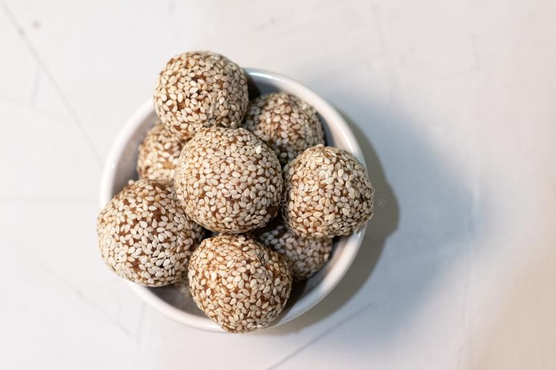 Homemade sweets energy balls made from superfoods like seeds, nuts and dried fruits. stock photography