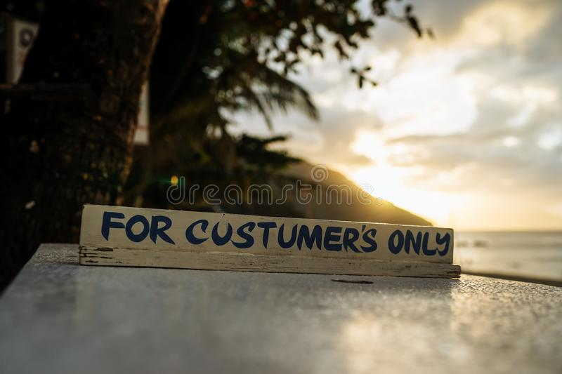 Homemade table-reel is reserved in open-air restaurant on the beach royalty free stock photo