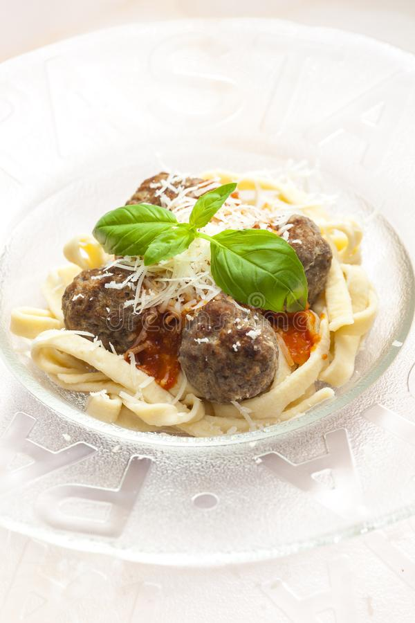 homemade tagliatelle with meatballs in tomato sauce royalty free stock images