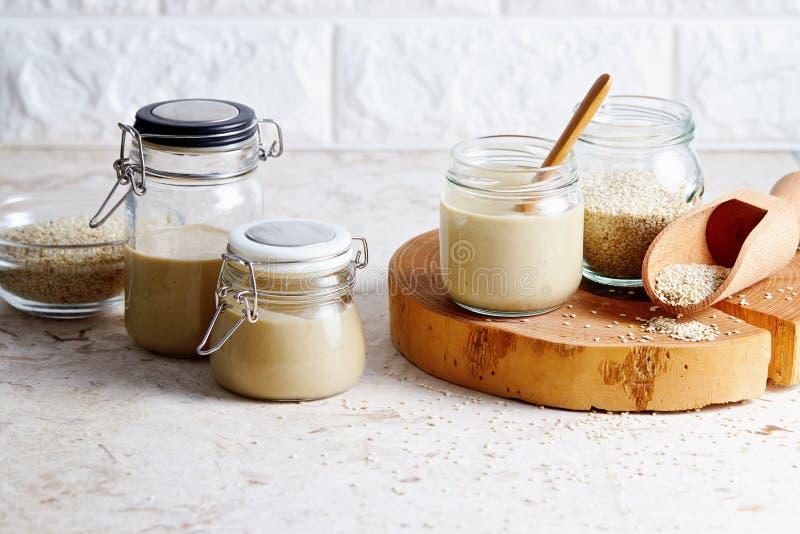 Homemade tahini in glass jars royalty free stock image