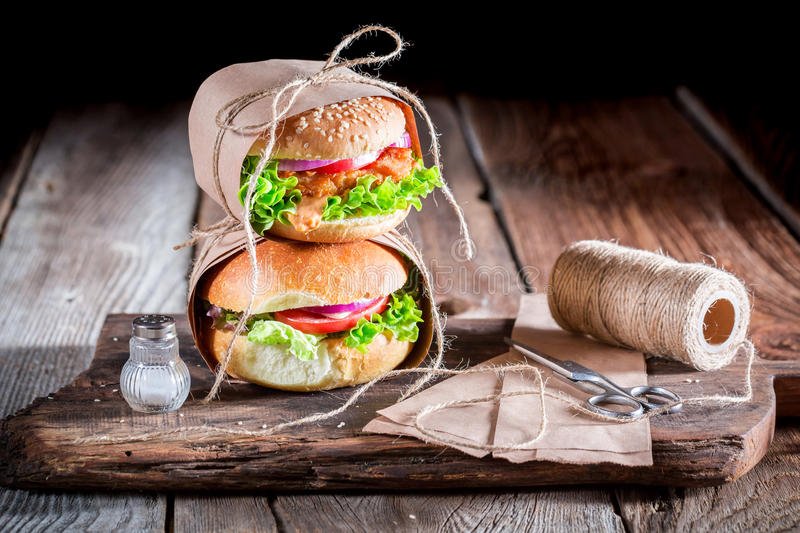 Homemade takeaway burger wrapped in paper royalty free stock image
