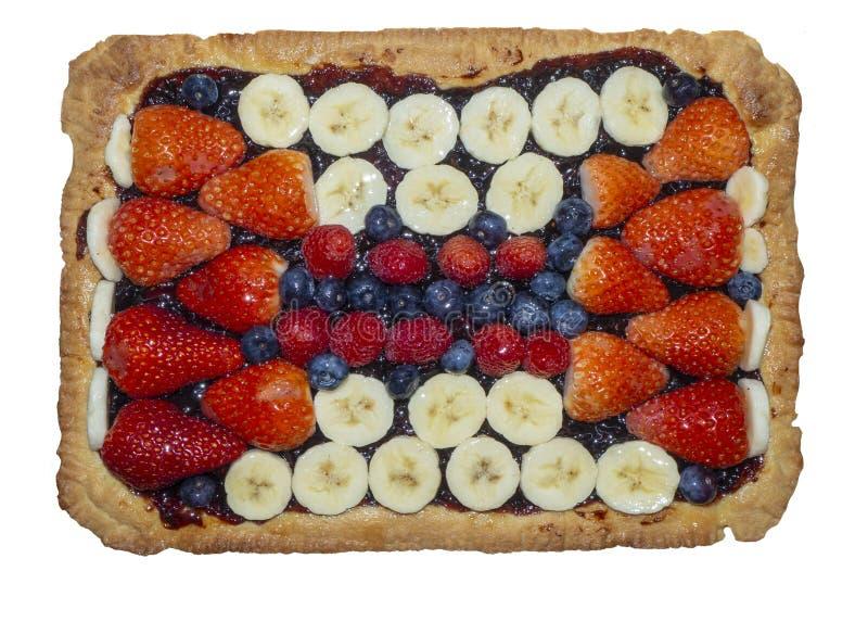 Homemade tart with fresh fruit, strawberries, bananas, blueberries and raspberries stock photo