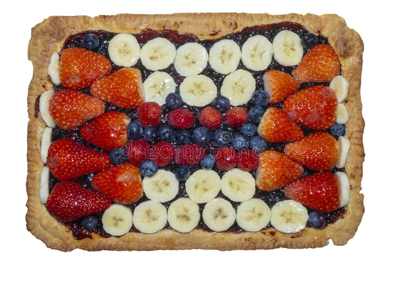 Homemade tart with fresh fruit, strawberries, bananas, blueberries and raspberries. Homemade tart with mix of fresh fruit, strawberries, bananas, blueberries and stock photo