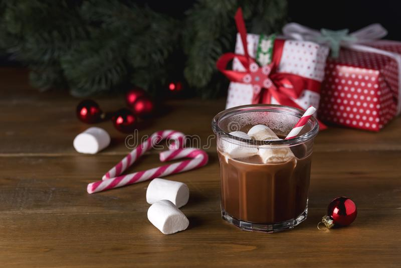 Homemade Tasty Hot Chocolate in Glass with Marshmallow Festive Christmas Background Candy Cane Horizontal Copy Space royalty free stock photos