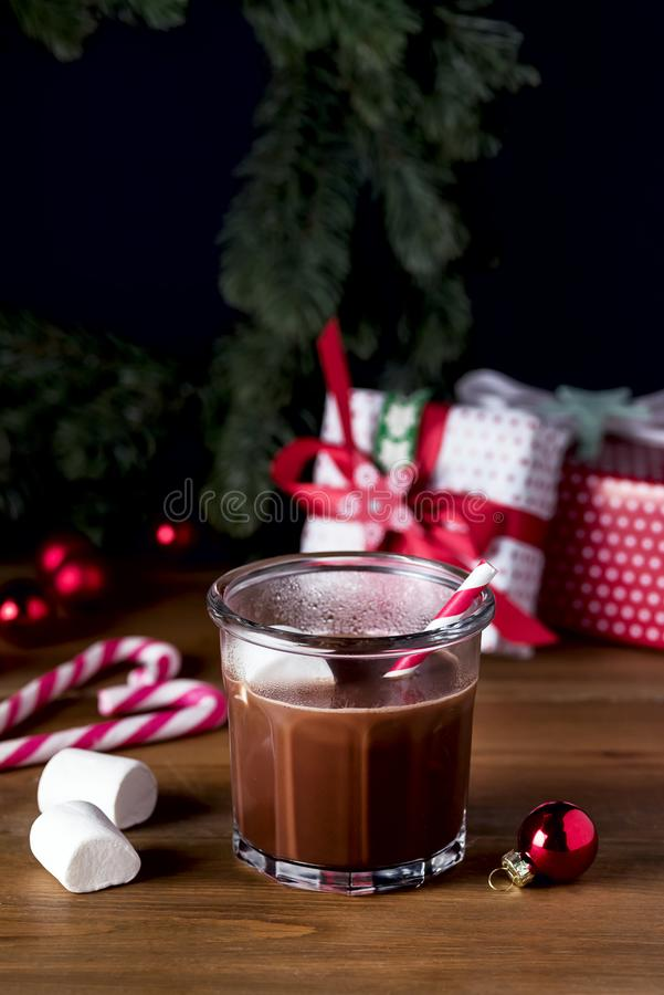 Homemade Tasty Hot Chocolate in Glass with Marshmallow Festive Christmas Background Candy Cane Vertical stock photography