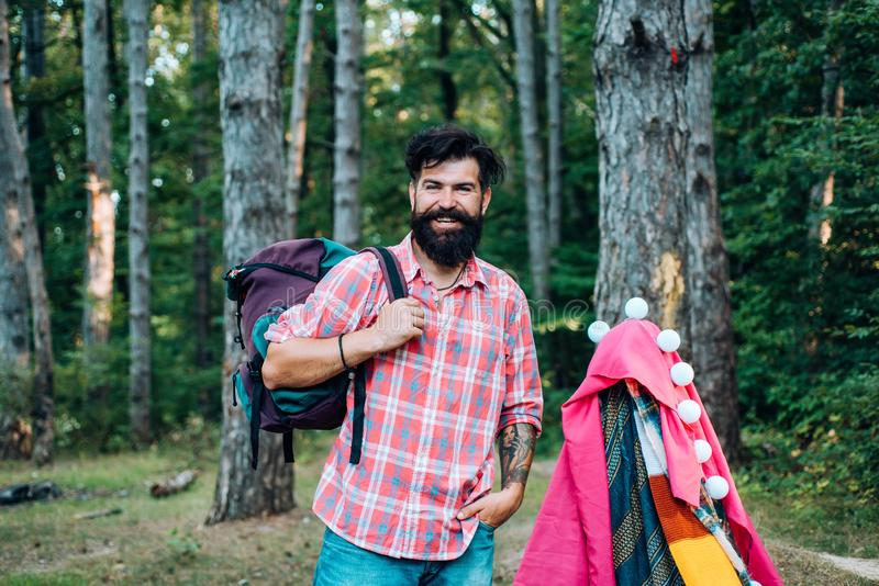 Homemade Tent Camping for free man. Summer camp and nature tourism. Go Ape Adventure. Happy man in summer. stock image