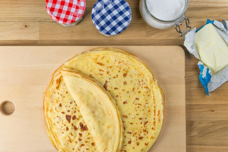 Homemade thin crepes for breakfast or dessert. The delicious french crepe with butter from top. Homemade thin crepes for breakfast or dessert. The delicious royalty free stock images