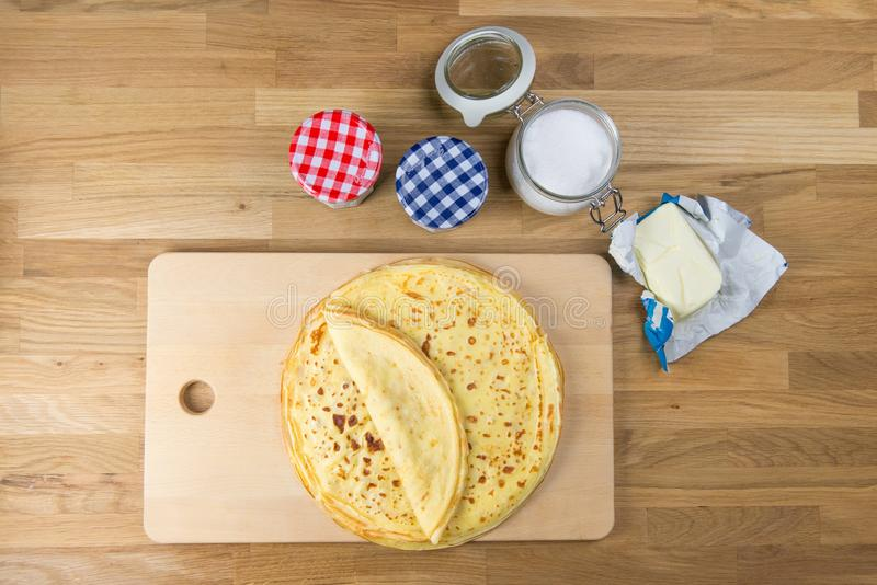 Homemade thin crepes for breakfast or dessert. The delicious french crepe from top. Homemade thin crepes for breakfast or dessert. The delicious french crepe stock photos