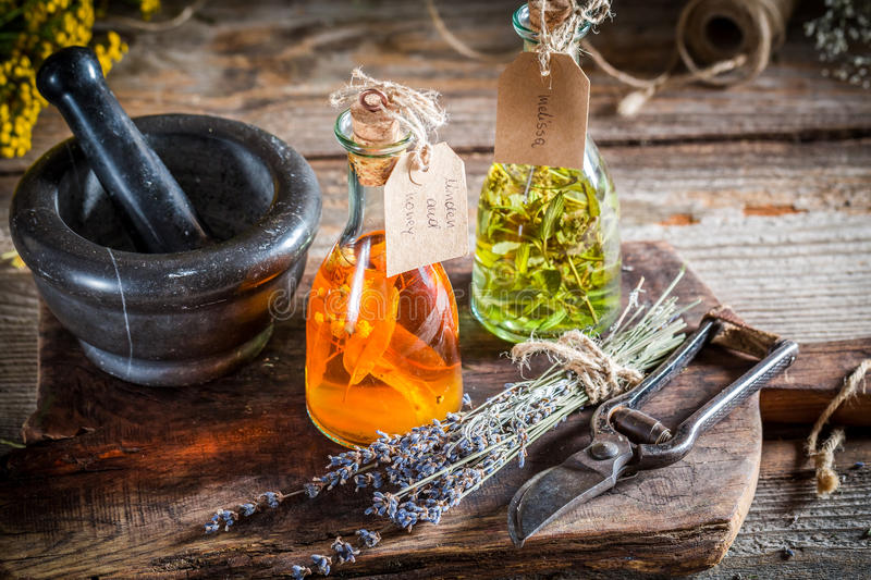 Homemade tincture in bottles with alcohol and herbs royalty free stock photography
