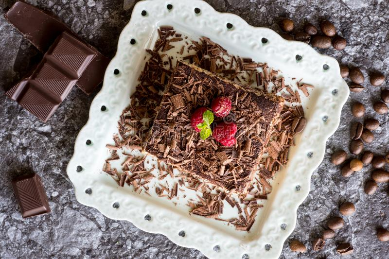 Homemade Tiramisu Cake Dessert with Grated Chocolate, Raspberry and Mint royalty free stock photography