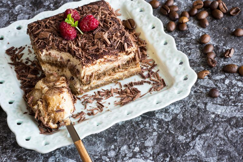 Homemade Tiramisu Cake Dessert with Grated Chocolate, Raspberry and Mint royalty free stock image