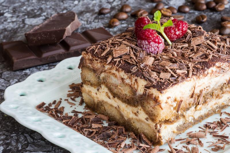 Homemade Tiramisu Cake Dessert with Grated Chocolate, Raspberry and Mint stock photography