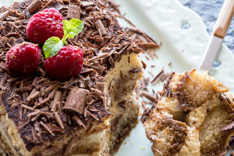 Homemade Tiramisu Cake Dessert with Grated Chocolate, Raspberry and Mint stock photos
