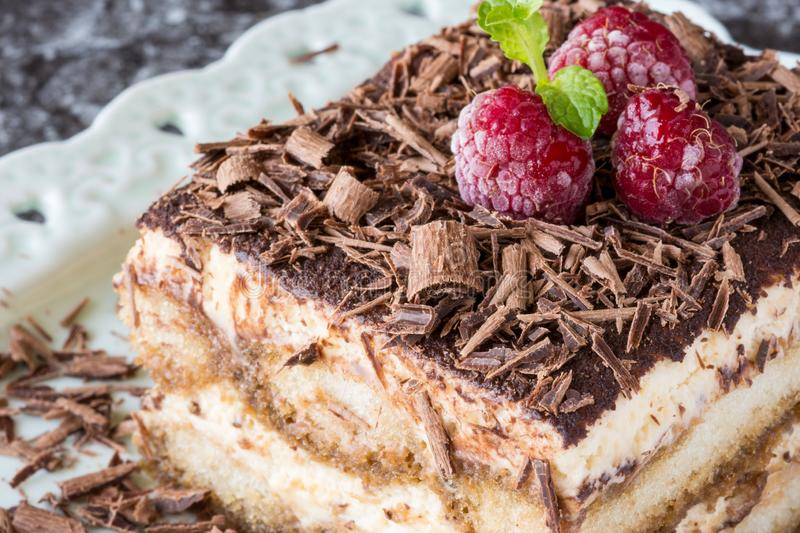 Homemade Tiramisu Cake Dessert with Grated Chocolate, Raspberry and Mint stock image
