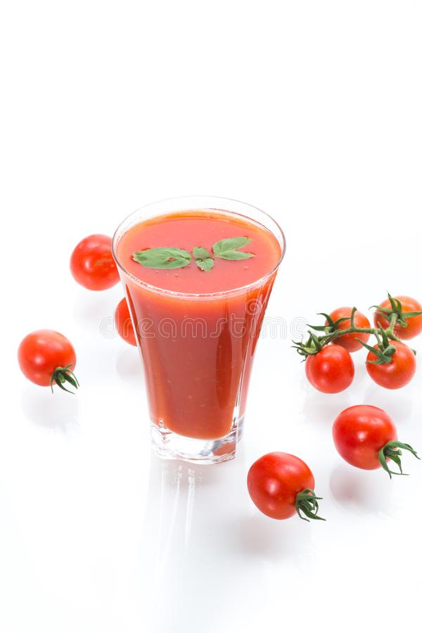 Homemade tomato juice in a glass and fresh tomatoes stock photos