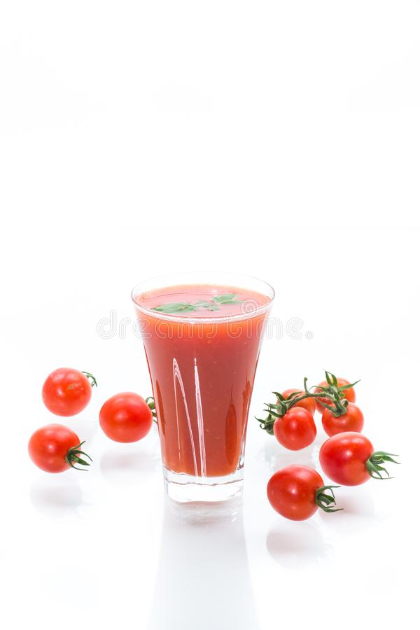 Homemade tomato juice in a glass and fresh tomatoes stock photo