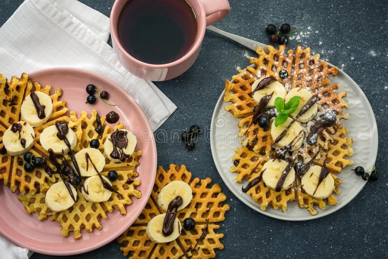 Belgian waffles. Homemade traditional Belgian waffles with chocolate and banana royalty free stock image