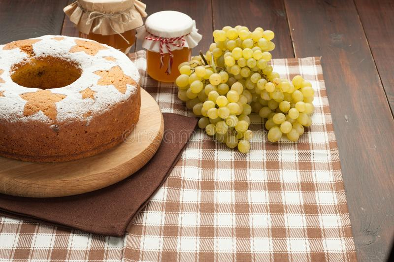 Homemade traditional fruit cake at wooden stand decorated with g royalty free stock photo