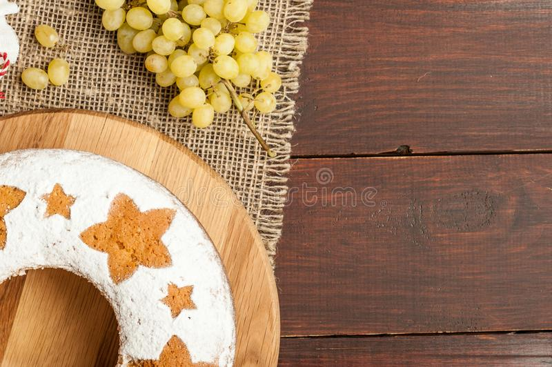 Homemade traditional fruit cake on wooden stand decorated with g stock photos