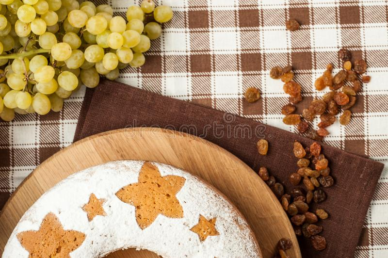Homemade traditional fruit cake on wooden stand decorated with r royalty free stock photography