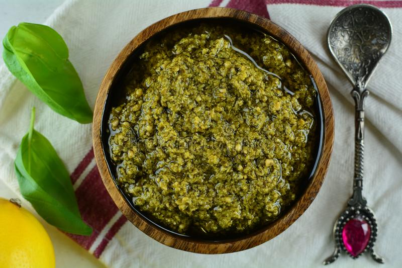 Homemade Traditional Mediterranean Basil Pesto - in a bowl. A set of photos showing a traditional Mediterranean basil pesto recipe in a bowl on white background stock photography