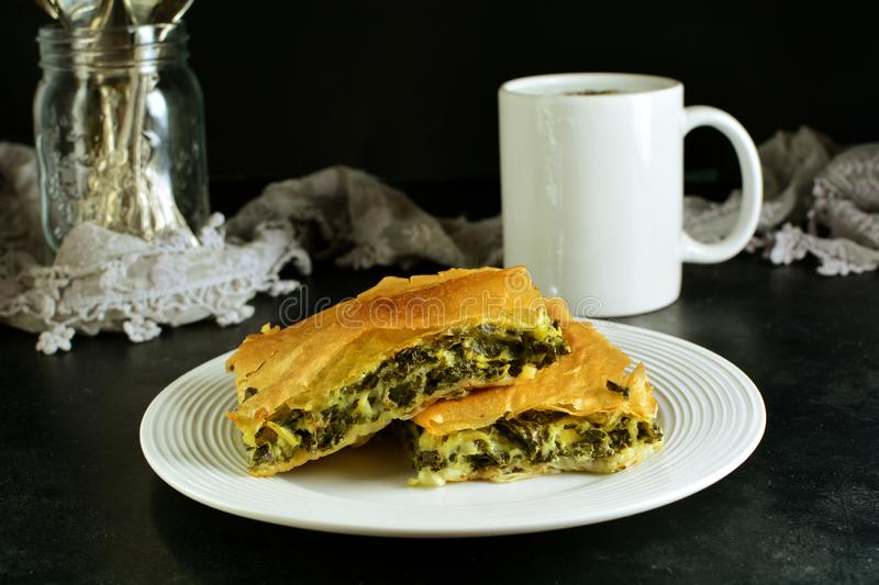 Homemade Traditional Mediterranean Spinach Pie with Cheese. A traditional Mediterranean pie made with spinach, cheese, eggs, and yufka stock photo