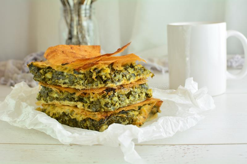 Homemade Traditional Mediterranean Spinach Pie with Cheese. A traditional Mediterranean pie made with spinach, cheese, eggs, and yufka royalty free stock image