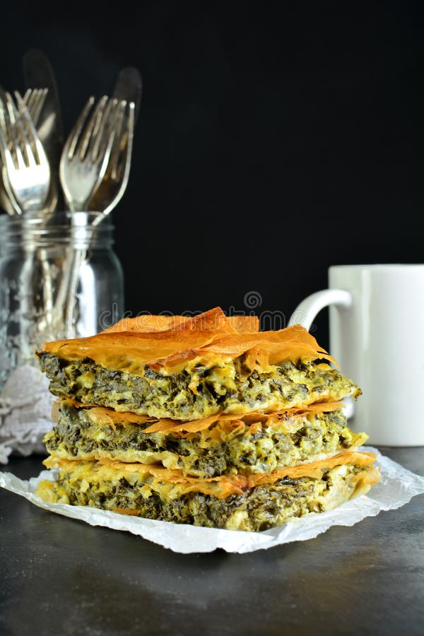 Homemade Traditional Mediterranean Spinach Pie with Cheese. A traditional Mediterranean pie made with spinach, cheese, eggs, and yufka royalty free stock photo