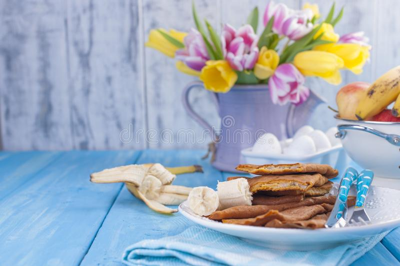 Homemade traditional pancakes with fruit and banana. Calorie food. European breakfast. American breakfast. Bright flowers of stock image