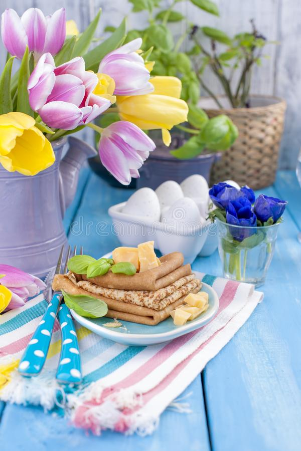 Homemade traditional pancakes with fruit and banana. Calorie food. European breakfast. American breakfast. Bright flowers of stock images