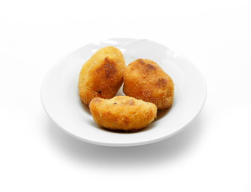 Homemade traditional Spanish croquettes on a white plate royalty free stock photo