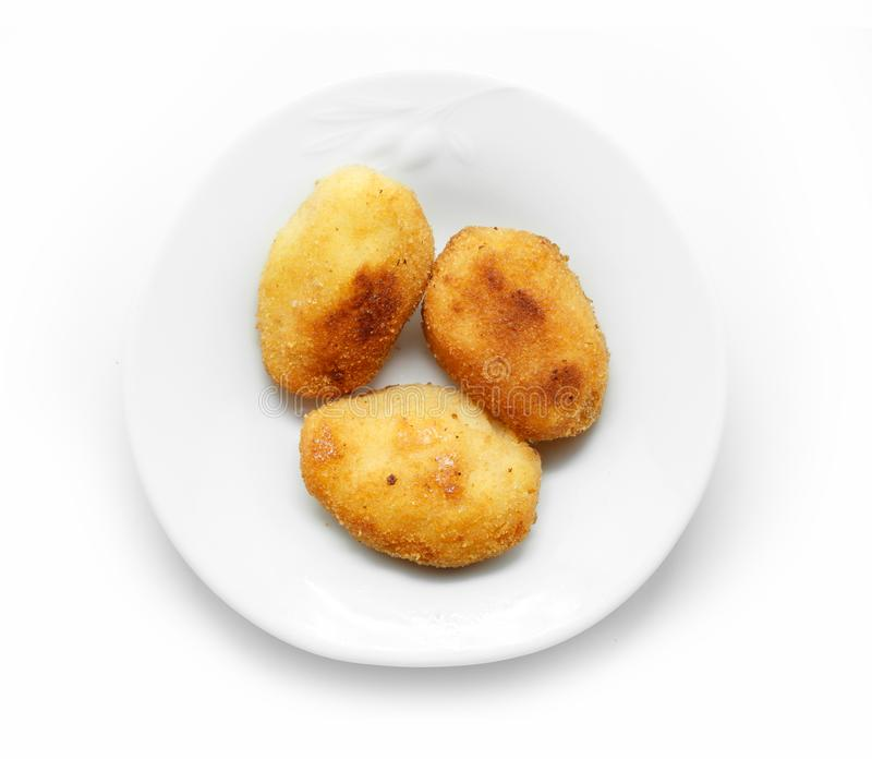 Homemade traditional Spanish croquettes on a white plate royalty free stock images