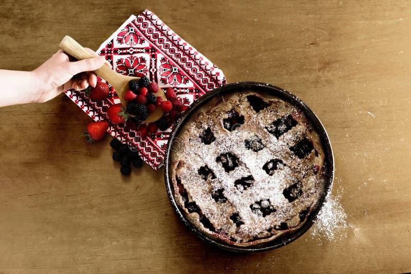 Homemade traditional tart dessert. On a wooden table closeup. Fresh berry tart. Top view stock image