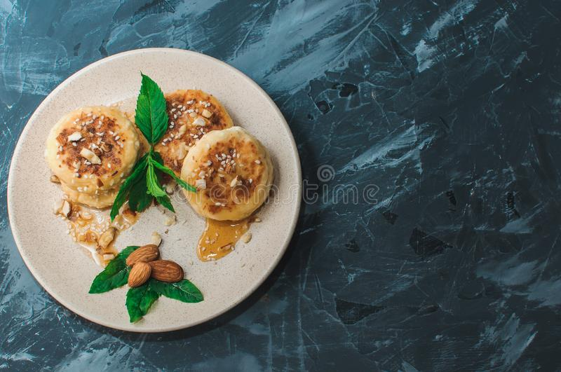 Homemade traditional Ukrainian and Russian cheesecakes, top view.Healthy food royalty free stock photography