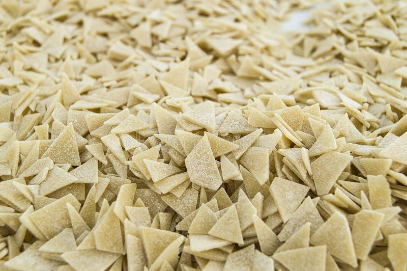 Homemade triangular cut dough granules homemade triangular cut dough granules in a plate Turkish style home made triangular cut do stock photography