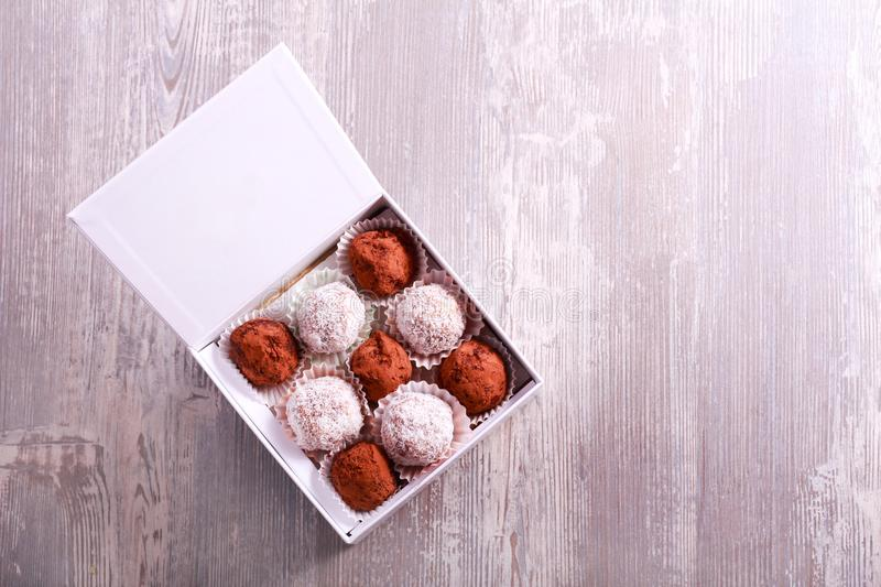 Homemade truffle and fruit candies in a box stock photos