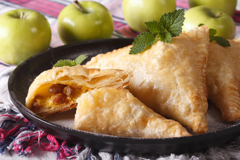 Homemade turnover pie with apples and raisins close-up. horizont stock photography