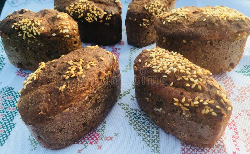 Homemade unleavened bread. Delicious and healthy homemade rye bread with sourdough with the addition of bran and white sesame seeds stock photos