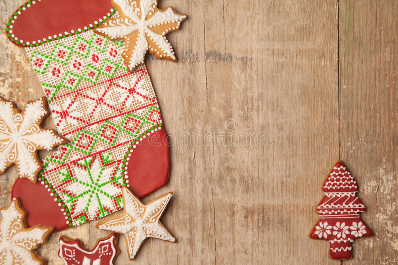 Homemade various christmas gingerbread cookies on wooden background royalty free stock photography