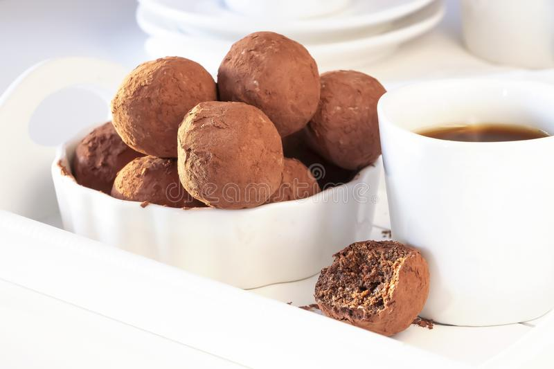 Homemade vegan chocolate truffles white plate morning light. Healthy tasty diet sweets concept royalty free stock photography