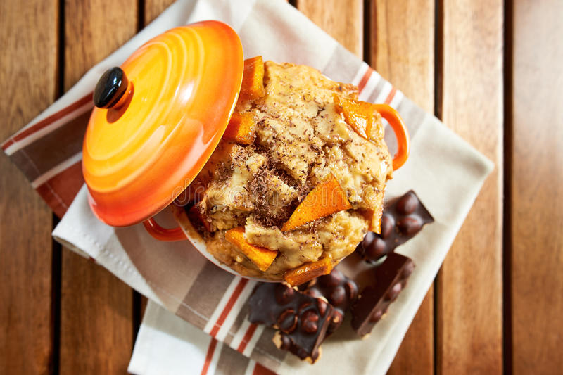 Homemade vegan muffin with candied orange and chocolate chips, s. Erved in cupcake with hazelnuts chocolate on a wooden background; top view royalty free stock images