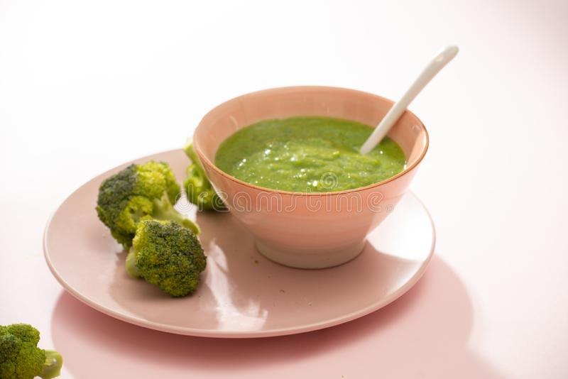 Homemade vegetable baby food. Broccoli puree for baby.  royalty free stock images