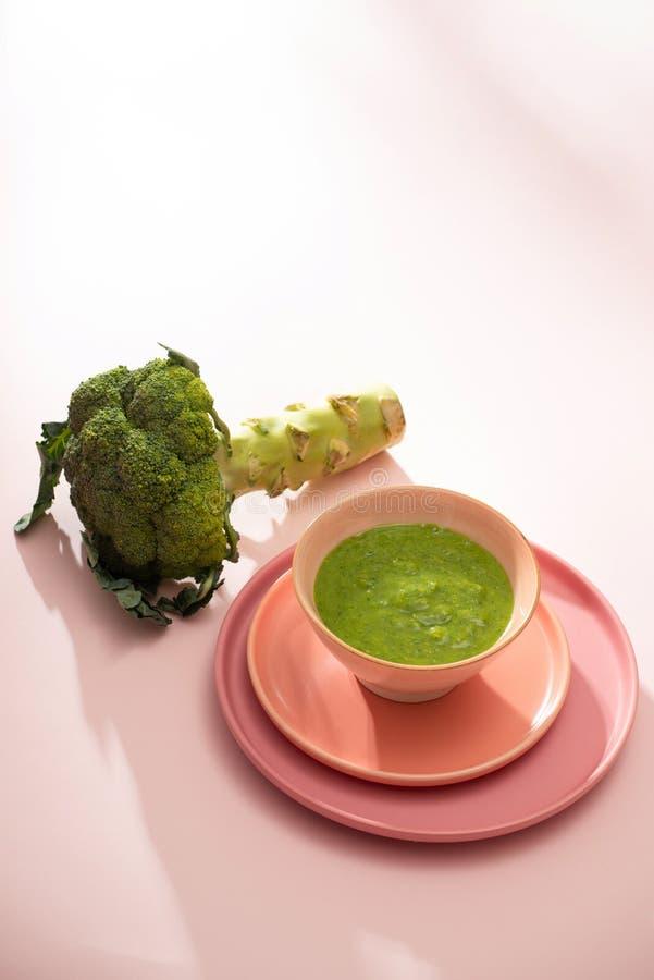 Homemade vegetable baby food. Broccoli puree for baby.  stock photos