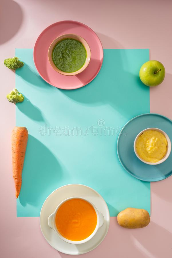 Homemade vegetable baby food purees in glass jars.  royalty free stock images
