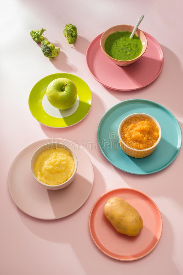Homemade vegetable baby food purees in bowl.  royalty free stock photos