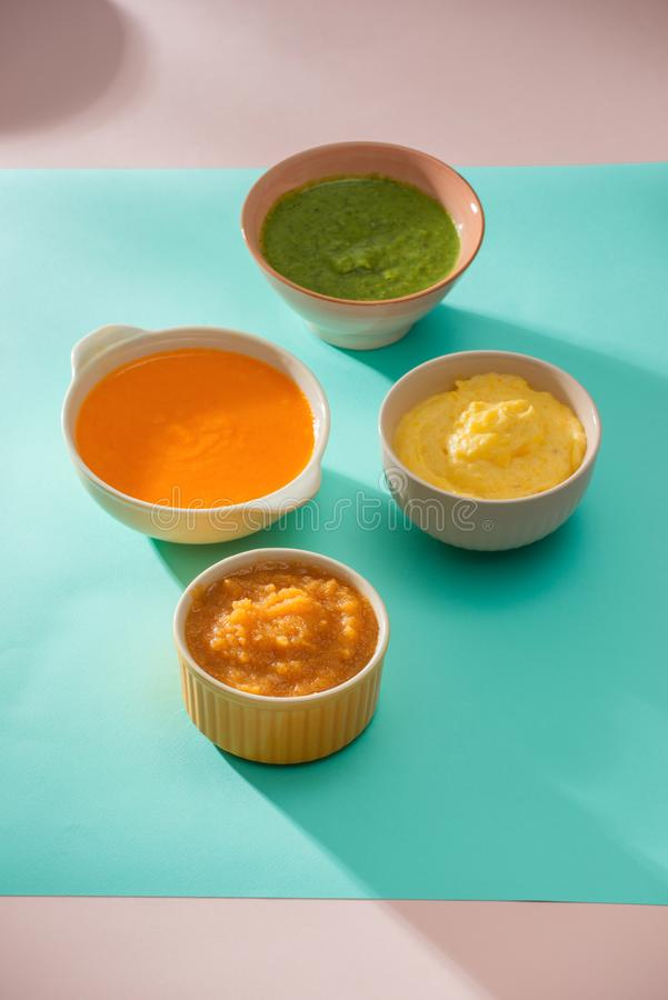 Homemade vegetable baby food purees in glass jars.  stock images
