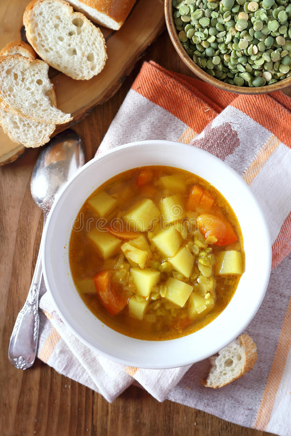 Homemade vegetable pea soup. Homemade vegetable split peas soup. Top view stock photo