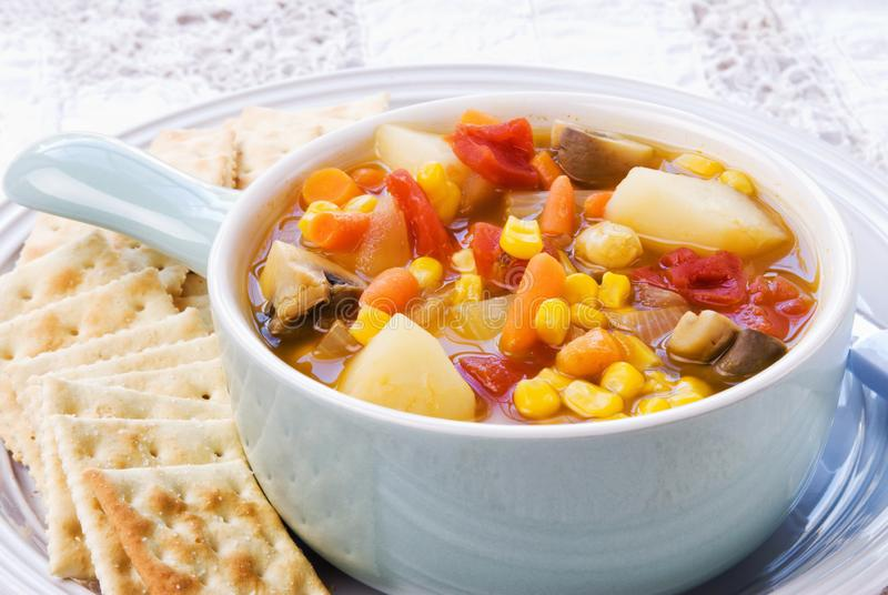 Homemade Vegetable Soup Served with Saltine Crackers royalty free stock image